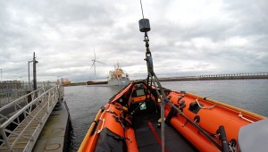 Karla C in the river Blyth as Blyth's inshore lifeboat is lowered into the water